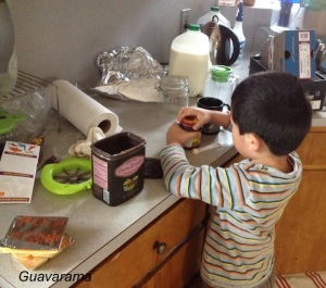 Mixing his own hot chocolate. We dial down the sugar. It's 1:1